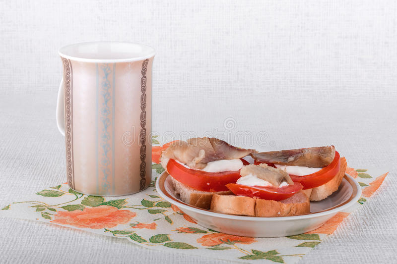 Sandwiches with tomatoes and pickled herring stock photo