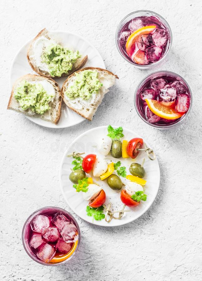 Free Sandwiches With Avocado, Canape With Mozzarella, Tomatoes, Olives And Aperol Spritz Royalty Free Stock Photography - 108883537
