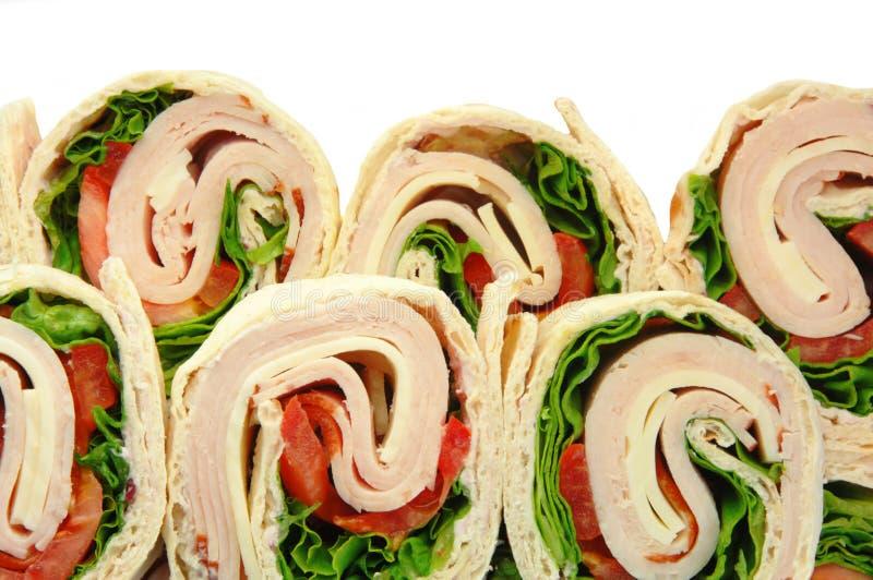 Sandwichs à enveloppe de la Turquie sur le blanc photographie stock