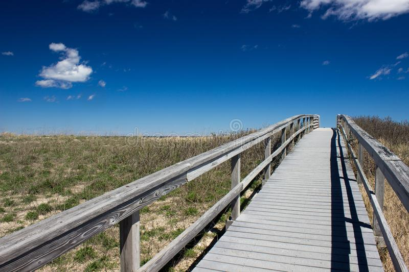 Sandwitch boardwalk beach at Cape Cod Massachusetts. Empty Sandwitch boardwalk beach in spring sunny day at Cape Cod Massachusetts, famous vacation dectination royalty free stock images