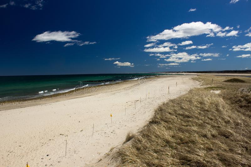 Sandwitch boardwalk beach at Cape Cod Massachusetts. Empty Sandwitch boardwalk beach in spring sunny day at Cape Cod Massachusetts, famous vacation dectination stock images