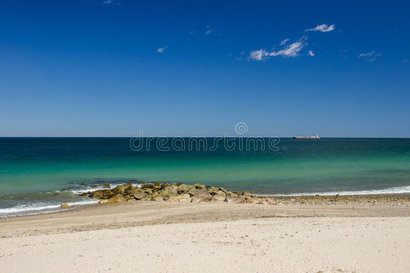 Sandwitch boardwalk beach at Cape Cod Massachusetts. Empty Sandwitch boardwalk beach in spring sunny day at Cape Cod Massachusetts, famous vacation dectination royalty free stock image