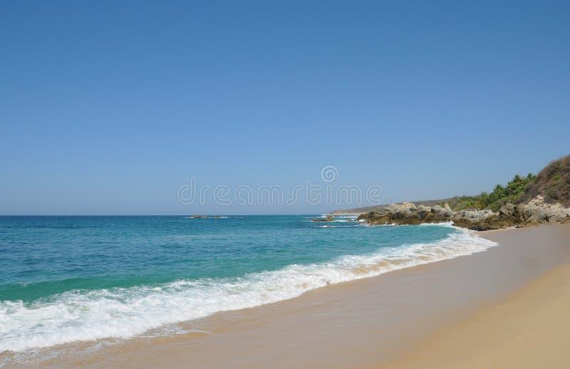 Sandy Bacocho Beach in Oaxaca Mexico. Surf sun and sand on a beach in Oaxaca Mexico stock photography