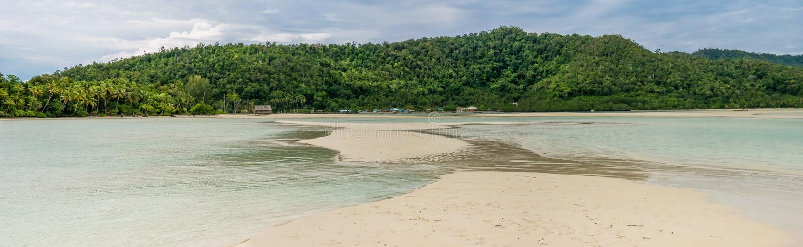 Sandy Bank in front of Local Village on Monsuar Island. Raja Ampat, Indonesia, West Papua. Sandy Bank in front of Local Village on Monsuar Island. Raja Ampat royalty free stock image
