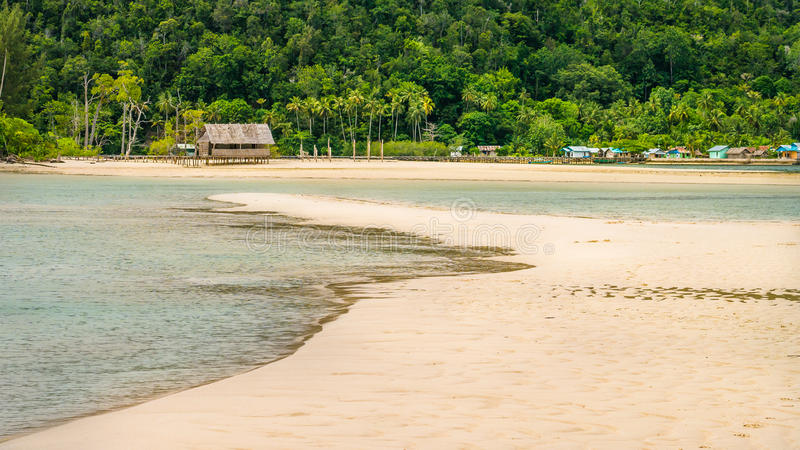 Sandy Bank in front of Local Village on Monsuar Island. Raja Ampat, Indonesia, West Papua. Sandy Bank in front of Local Village on Monsuar Island. Raja Ampat stock images