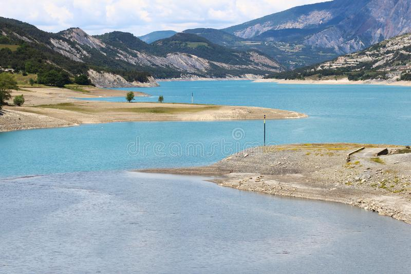 Sandy banks along the Ubaye River, Hautes-Alpes, France. Lac de Serre-Poncon is a lake in southeast France and one of the largest artificial lakes in western royalty free stock images