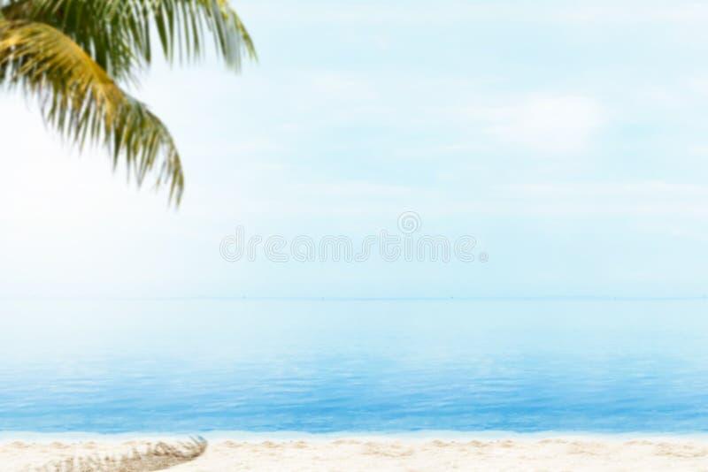 Sandy beach with the blue ocean stock photos