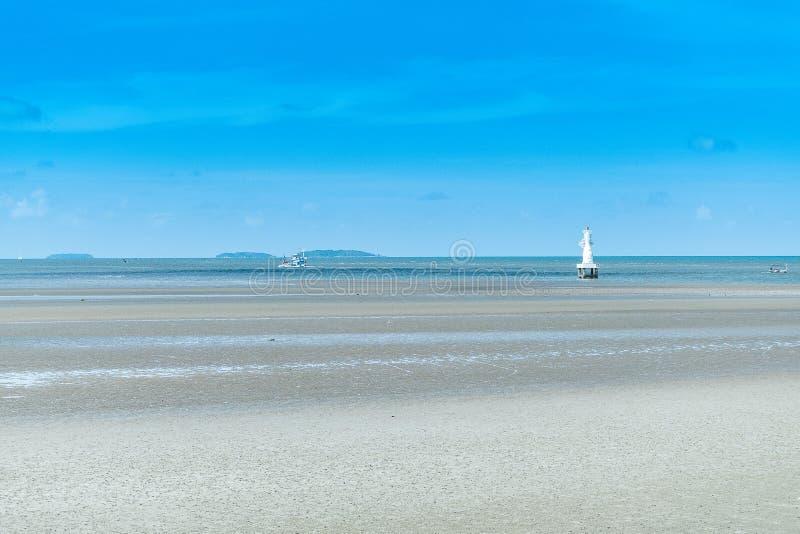 Sandy beach and blue sea with waves stock photos