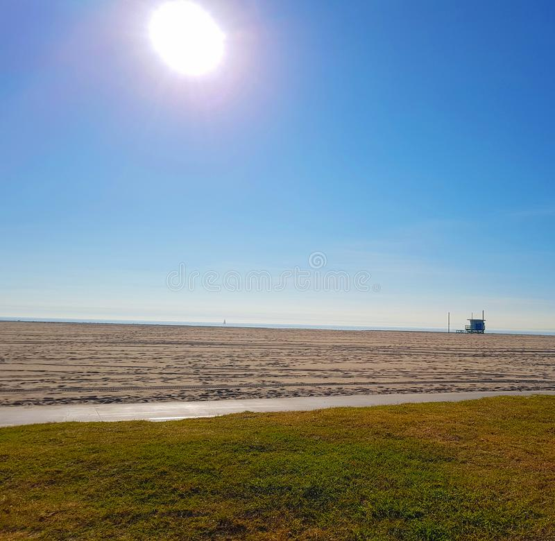 Sandy beach on a bright sun. Sand and grass stock photo
