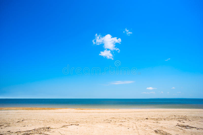 Sandy beach and cloud on blue sky . royalty free stock images