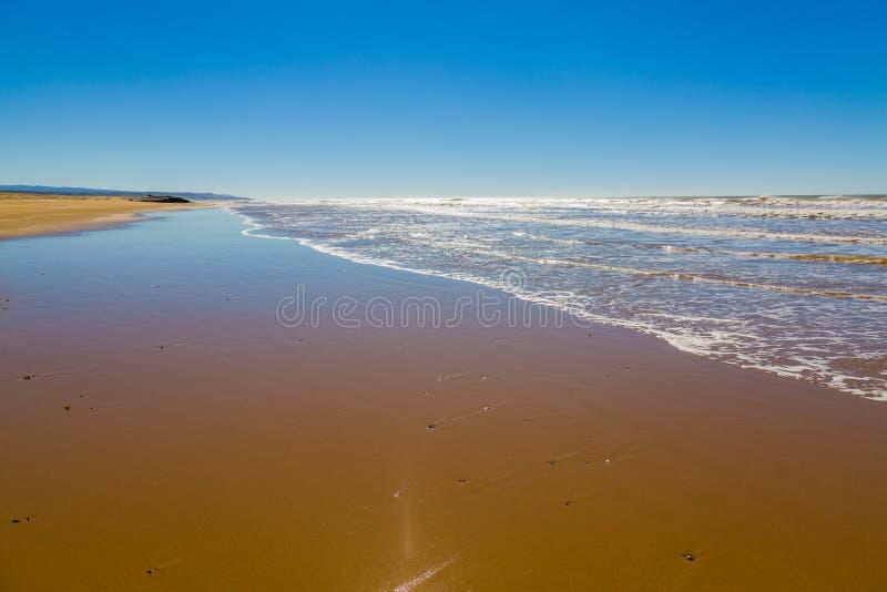 Sandy beach on the coast near Essaouira. Morocco stock photo