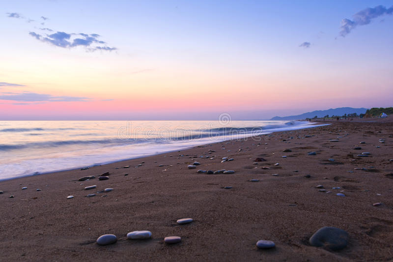 Sandy beach at the dusk, Peloponnese - Greece. View of a beautiful sandy beach at the dusk. Coastline of Kyparissia, Peloponnese - Greece. Long exposure shot stock images