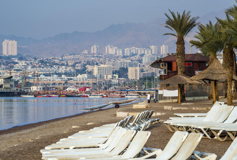 Sandy beach of Eilat. Eilat is a famous city with beautiful beaches and resort hotels packed with thousands relaxing tourists from around the world royalty free stock images