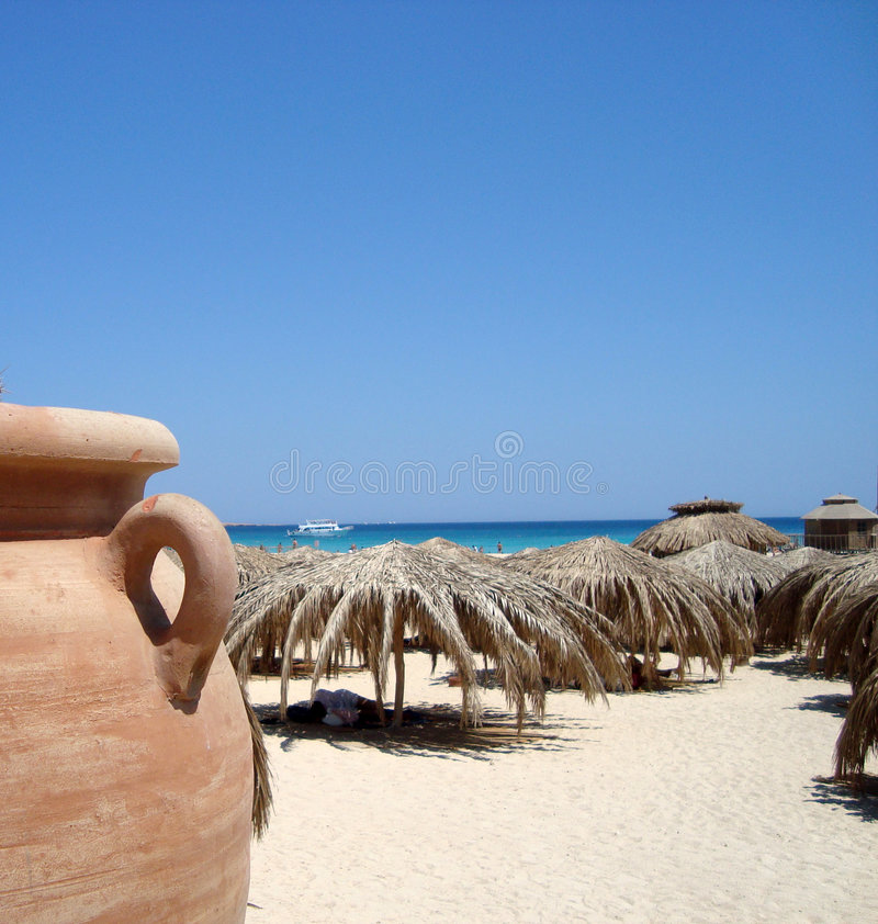 Download Sandy beach and palm huts stock image. Image of egypt - 5924321