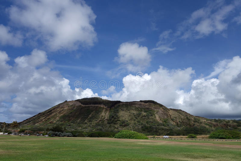 Sandy Beach Park grass field and Koko Head Crater. In the background on Oahu, Hawaii stock photography