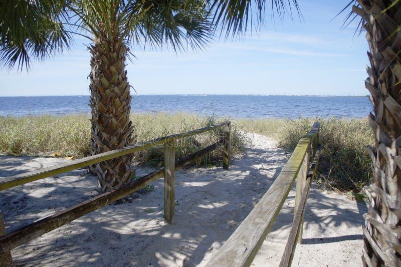 Sandy beach path stock images