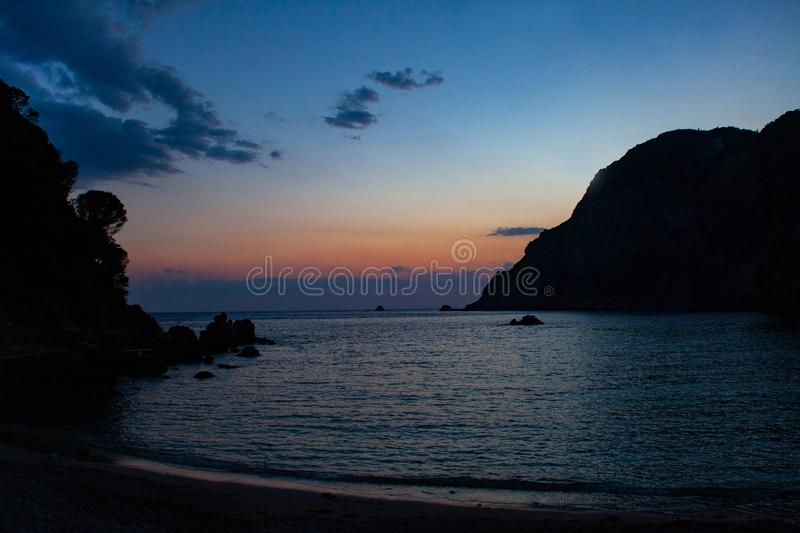 A sandy beach at the sea in the dusk with a blue sky in the background. Calm and peace concept on the holiday. royalty free stock photography