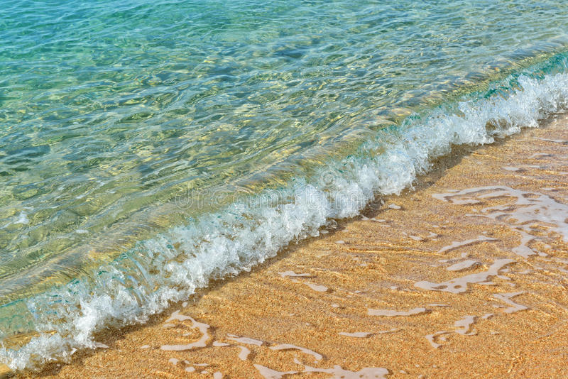 Sandy beach and sea waves. In sunny day very detailed stock photos