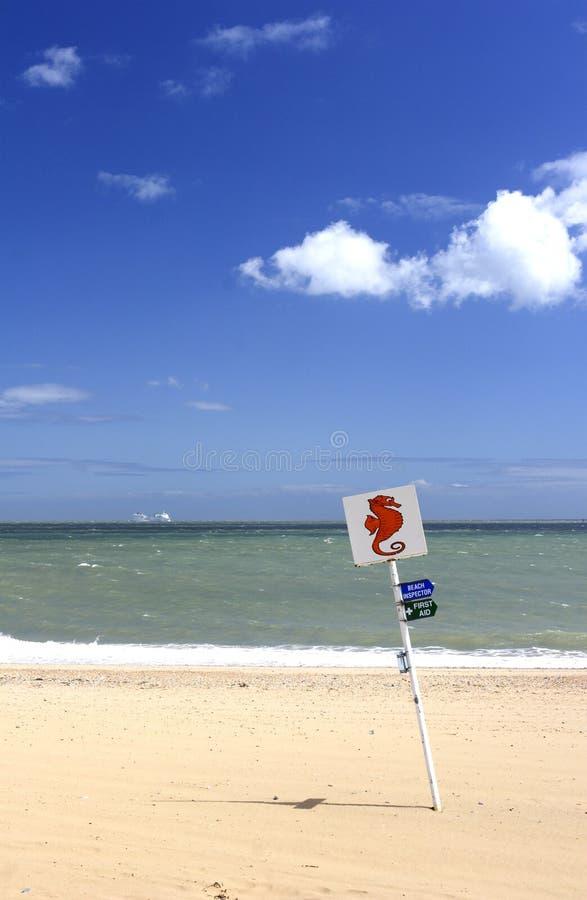 Sandy beach and sign