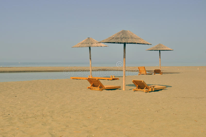 Download Sandy beach with sunbeds stock image. Image of empty - 15290065