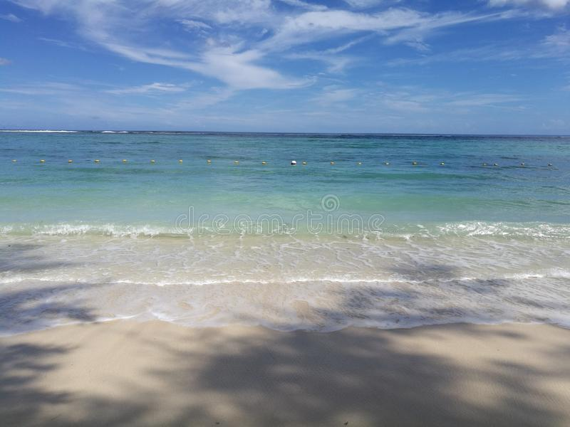 Sandy beach and torquise sea royalty free stock images