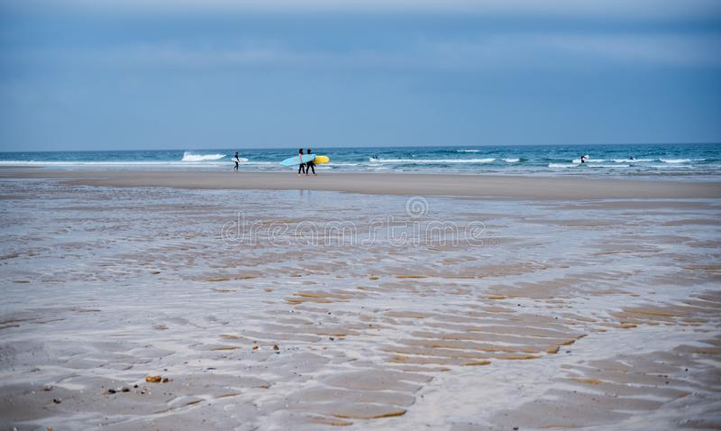 Surfers on the coast of the Atlantic Ocean. France. Landes. royalty free stock image