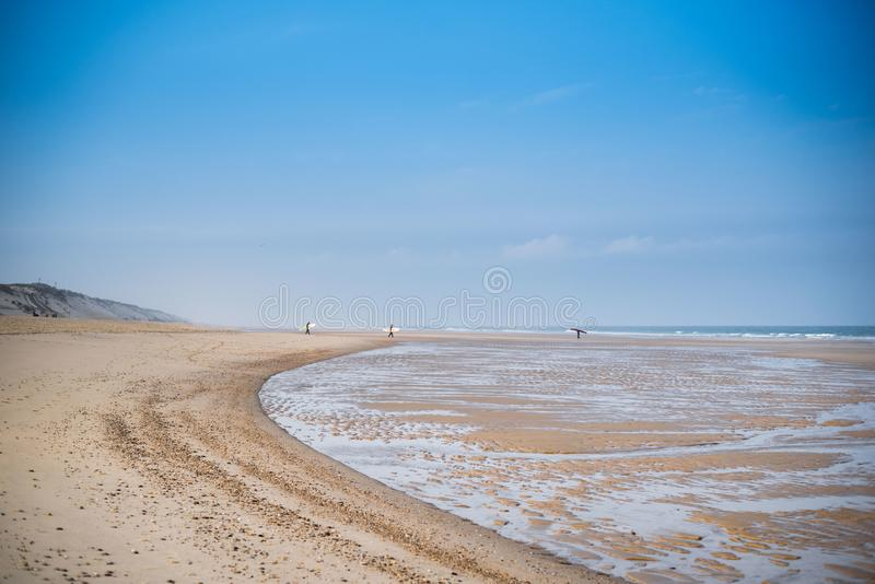 Surfers on the coast of the Atlantic Ocean. France. Landes. stock photos