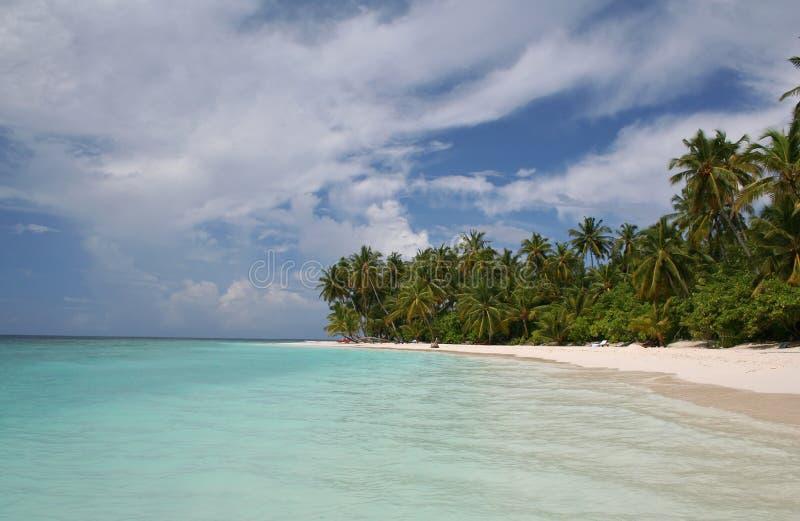 Sandy beach and tropical sea stock photo