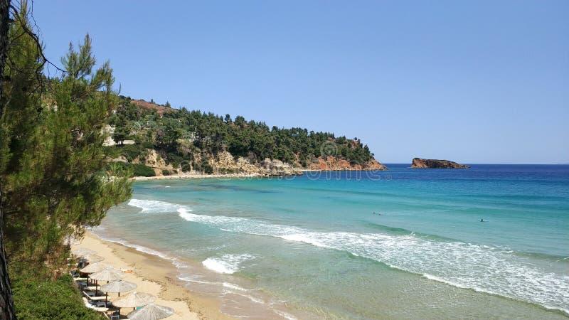 Sandy beach, turquoise waters, Greece islands stock photos