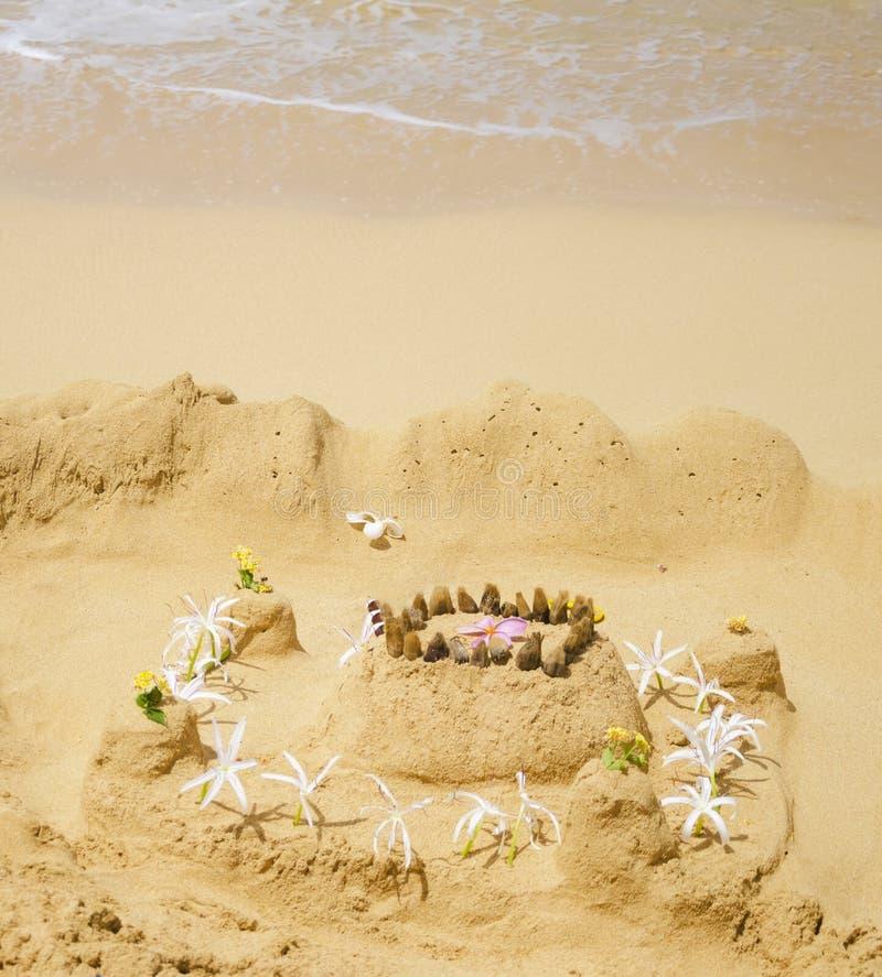 Sandy castle on the beach
