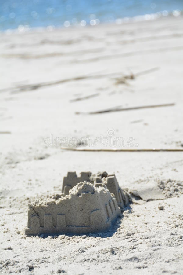 Sandy castle at the South beach in the hot summer stock photo