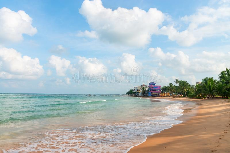 Sandy coast beach and hotels with sea view. Sandy coast beach with clean sea water and hotels with sea view on background royalty free stock photos