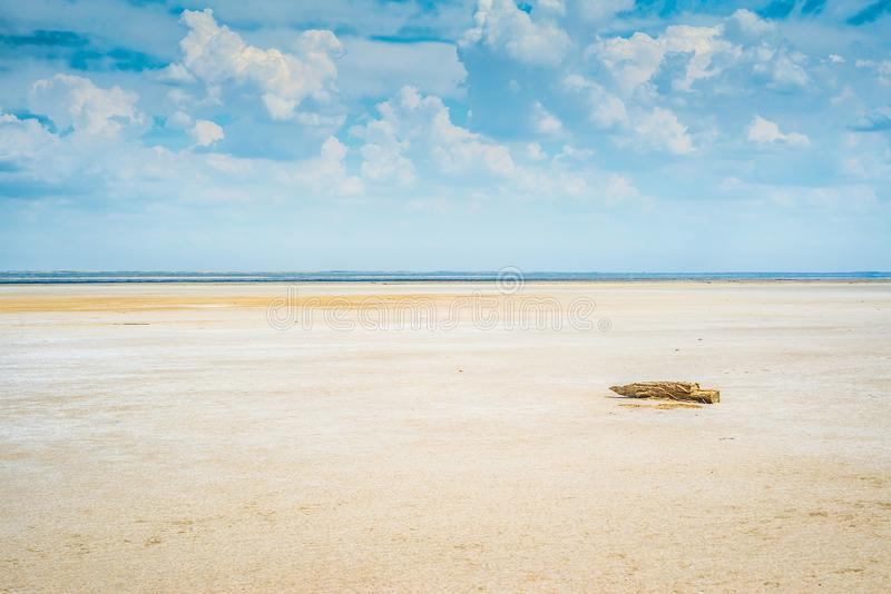 Sandy coastline of the salty lake Baskunchak. Lifeless hot terrain without vegetation and animals. Russia. Astrakhan region royalty free stock image
