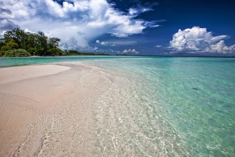 Sandy coastline on sunny day royalty free stock image
