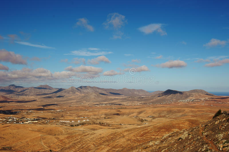 Sandy hills and blue sky royalty free stock photography