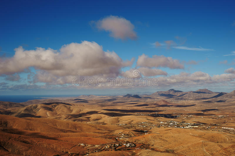 Sandy hills and blue sky royalty free stock image