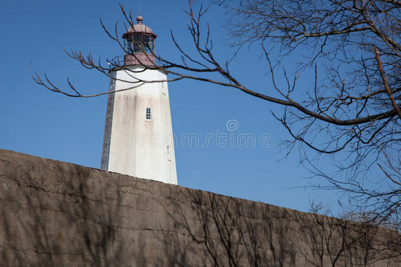 Sandy Hook Lighthouse. A view of the famous Sandy Hook Lighthouse at Fort Hancock in New Jersey. This is the oldest operating lighthouse in the United States stock photography