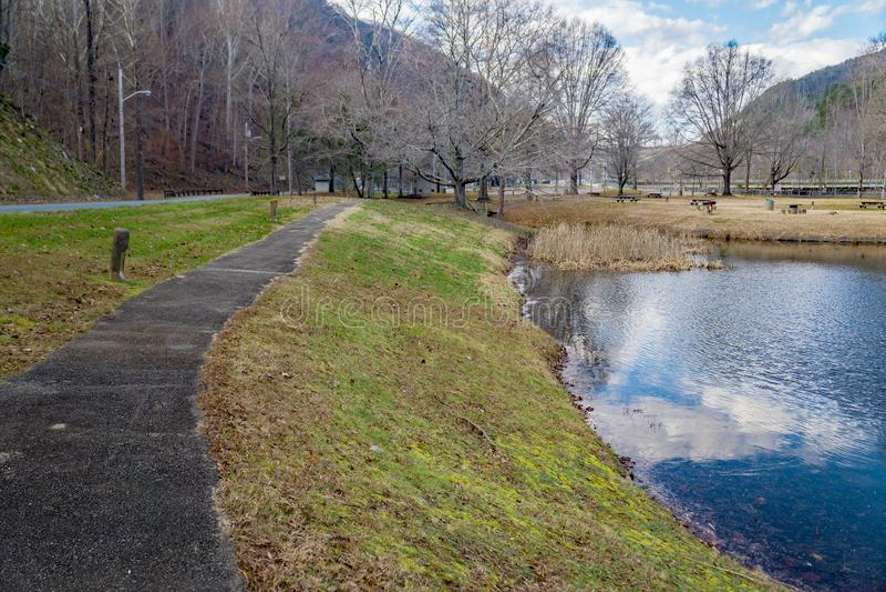 Walking Trail and Lake at Smith Mountain Dam Picnic Area. Sandy Level, VA – January 8th:Walking trail and lake at Smith Mountain picnic area at the Smith royalty free stock photography