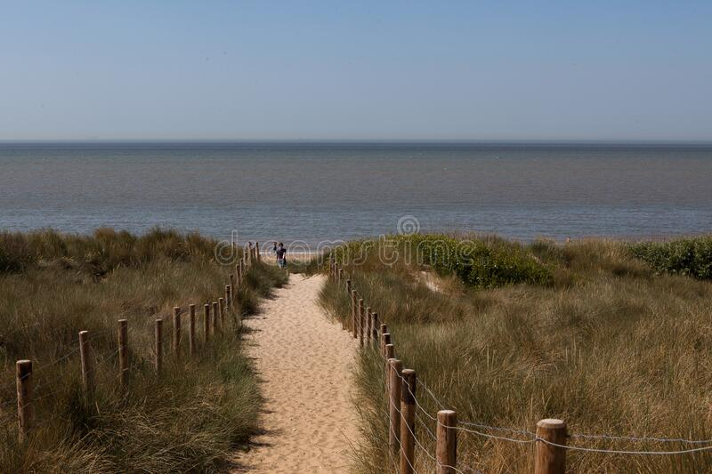 Barbwire dunes sandy path North Sea, Blankenberge, Belgium royalty free stock images