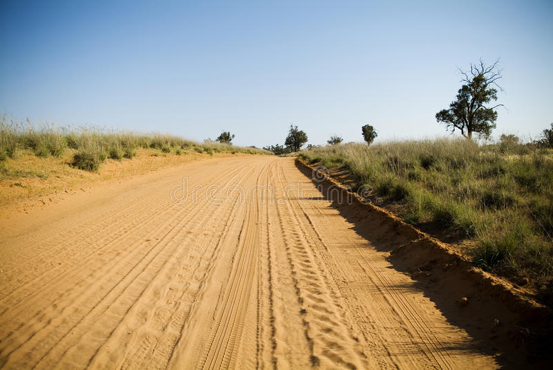 Sandy Road. Dry and dusty red dirt road in Australia stock images