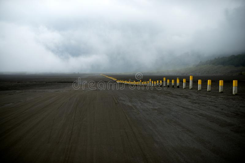 Sandy road in the caldera Bromo Tengger Semeru National Park. Volcanic landscape in Indonesia in Java stock images
