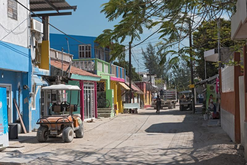 Sandy road with tourists and stalls on Holbox Island, Quintana R. Oo, Mexico located in north yucatan peninsula royalty free stock image