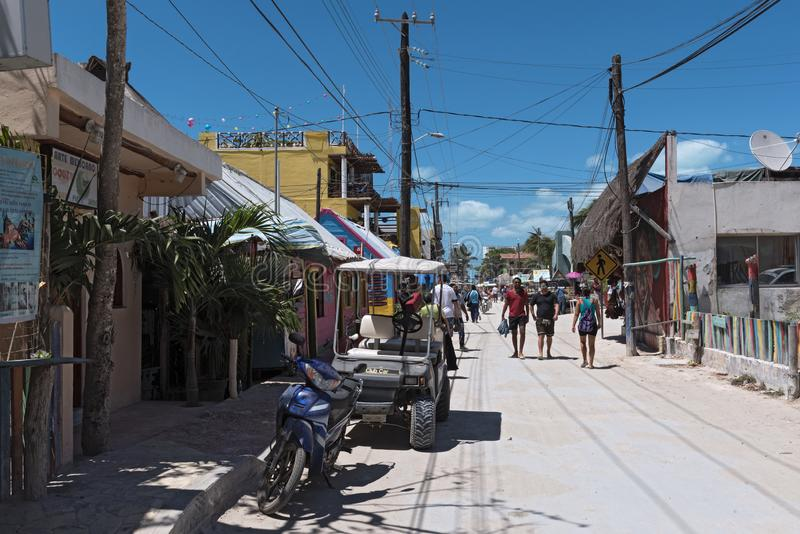 Sandy road with tourists and stalls on holbox island, quintana r. Oo, mexico located in north yucatan peninsula royalty free stock photos