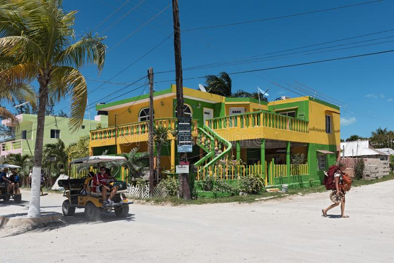 Sandy road with tourists and stalls on holbox island, quintana r. Oo, mexico located in north yucatan peninsula stock images