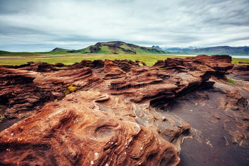 Sandy rocks formed by winds. Location Sudurland, cape Dyrholaey, Iceland, Europe. stock photography