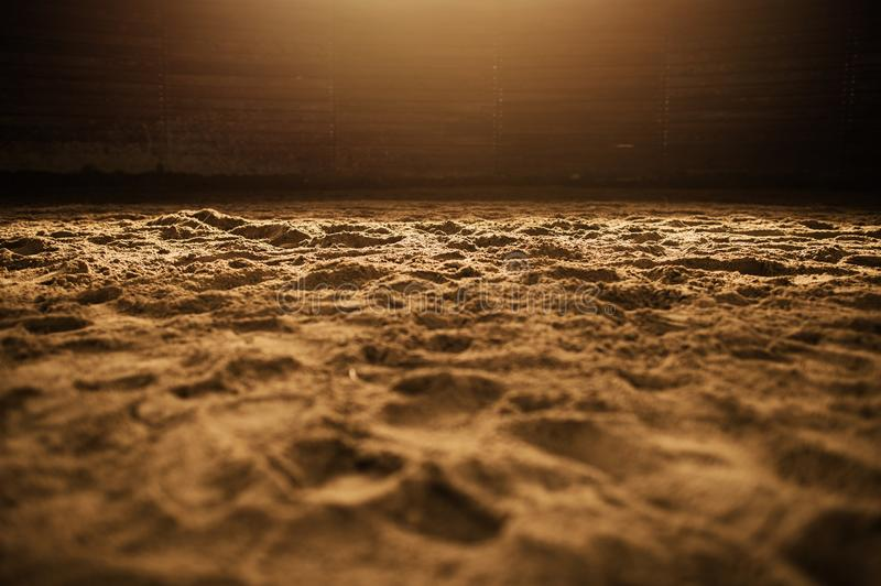 Sandy Rodeo Arena. In the Warm Spotlight Closeup Photo royalty free stock images