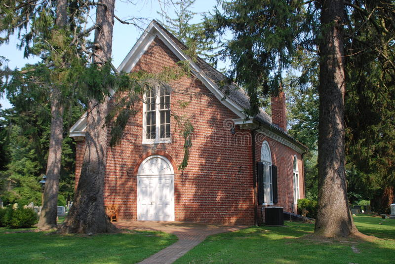 Sandy's Point, MD: Historic St. Paul's Church. Stately Cedar trees surround the small historic 1773 St. Paul's Church set in the woods at Sandy's Point, Maryland royalty free stock images
