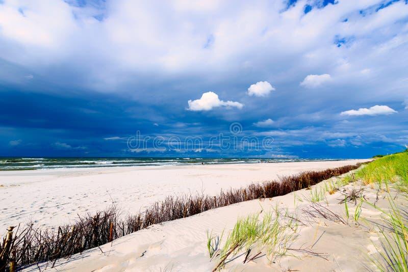 Sandy seaside beach and cloudy sky. Over the Baltic Sea stock photos