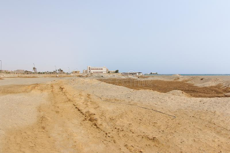 Sandy Shore, Marsa Alam, Egypt. A large sandy shore in Marsa Alam City, Egypt with buildings in distance. Marsa Alam is a popular tourists destination, beautiful royalty free stock images