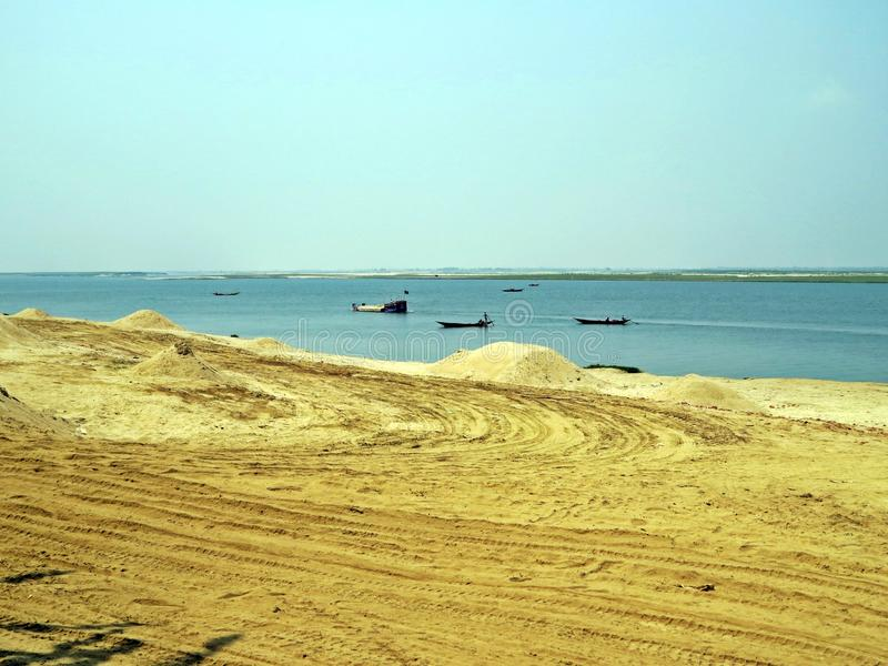Padma River in Kushtia, Bangladesh. Sandy shore of Padma River near Kushtia in Bangladesh royalty free stock photo